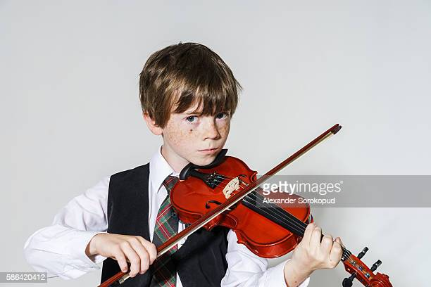 freckled red-hair boy playing violin - liver spot stock photos and pictures