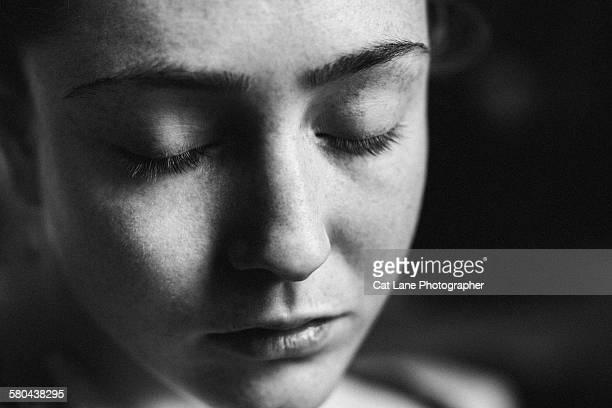 Freckled woman with eyes closed