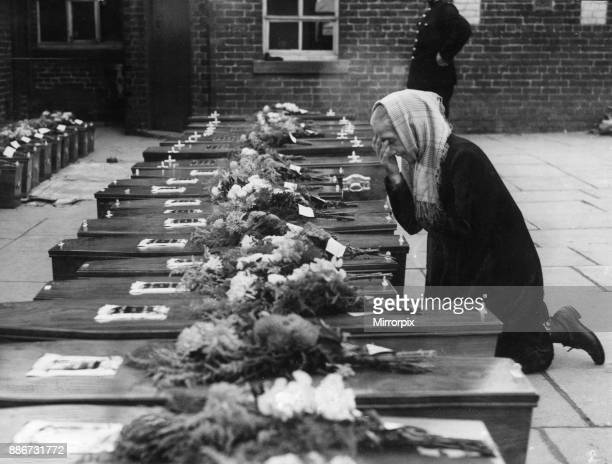 Freckleton Air Disaster 23rd August 1944 An aged villager knells in prayer before the coffins of the thirty six school children who where killed when...