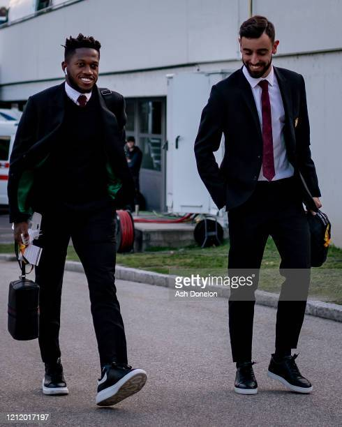 Fred and Bruno Fernandes of Manchester United arrive ahead of the UEFA Europa League round of 16 first leg match between LASK and Manchester United...