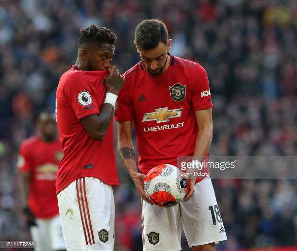 Fred and Bruno Fernandes of Manchester United discuss a free kick during the Premier League match between Manchester United and Manchester City at...