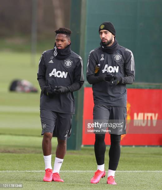 Fred and Bruno Fernandes of Manchester United in action during a first team training session at Aon Training Complex on March 11 2020 in Manchester...
