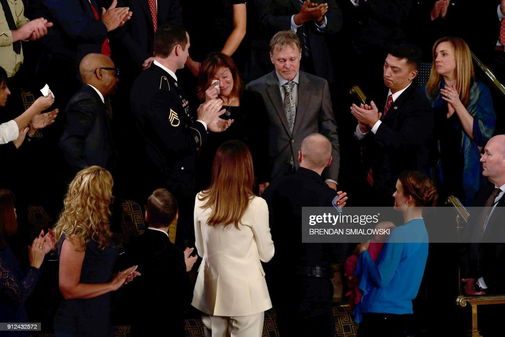 TOPSHOT - Fred and Cindy Warmbier are recognized during the State of the Union address at the US Capitol in Washington, DC, on January 30, 2018. PHOTO / Brendan Smialowski