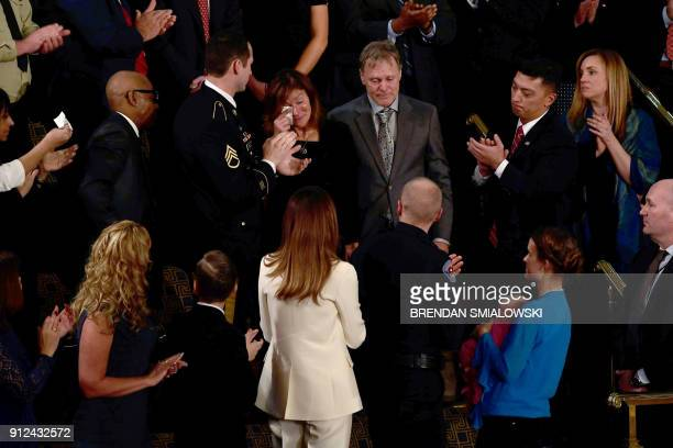 TOPSHOT Fred and Cindy Warmbier are recognized during the State of the Union address at the US Capitol in Washington DC on January 30 2018 PHOTO /...