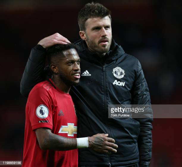 Fred and Coach Michael Carrick of Manchester United walk off after the Premier League match between Manchester United and Norwich City at Old...