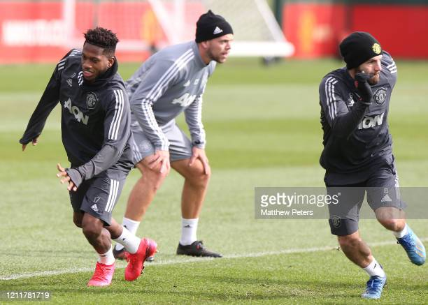 Fred and Juan Mata of Manchester United in action during a first team training session at Aon Training Complex on March 11 2020 in Manchester England