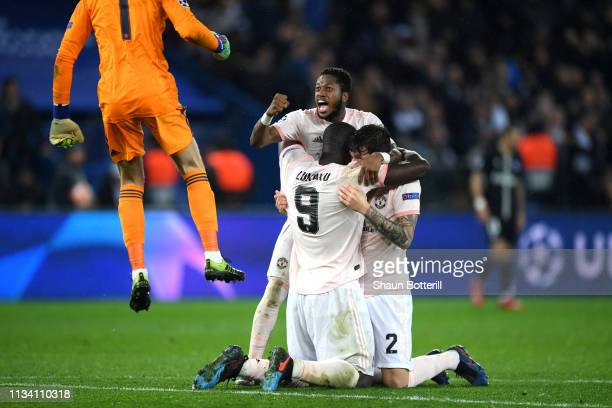 Fred and Manchester United team mates celebrate victory during the UEFA Champions League Round of 16 Second Leg match between Paris SaintGermain and...