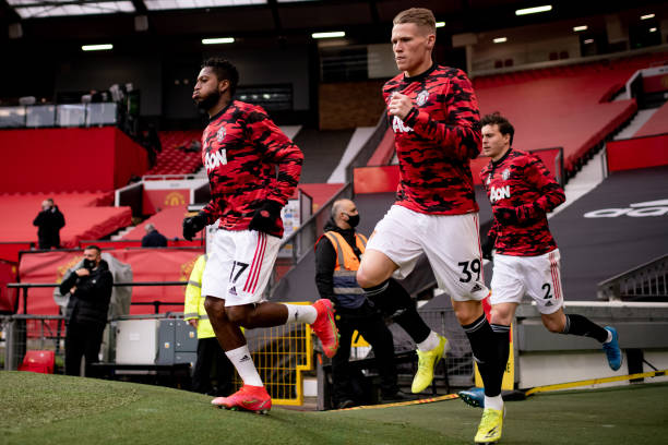 Fred and Scott McTominay of Manchester United run out to warm up prior to the Premier League match between Manchester United and Liverpool at Old...