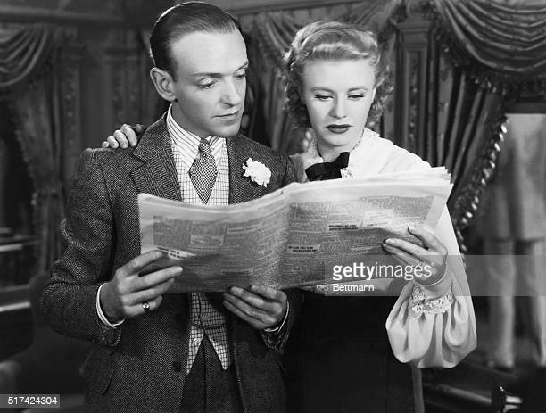 Fred Astaire and Ginger Rogers read a newspaper in a scene from the 1939 film The Story of Vernon and Irene Castle