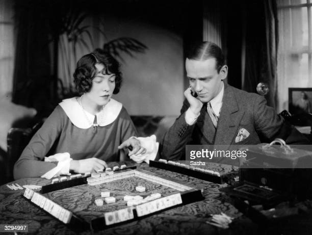 Fred Astaire and his sister Adele playing Mah Jong