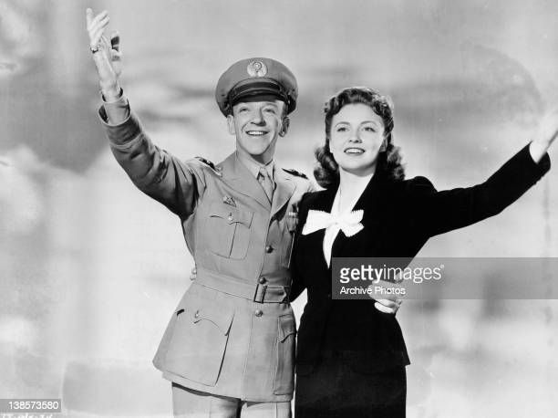 Fred Astaire and Joan Leslie raise their arms in a scene from the film 'The Sky's the Limit' 1943