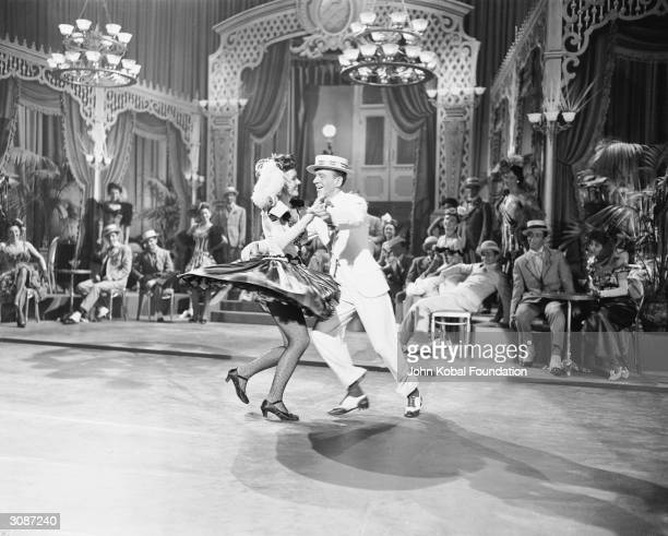 Fred Astaire and partner film a dance scene for the MGM film 'Easter Parade' directed by Charles Walters 25th November 1947
