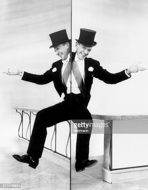 Fred Astaire dances alongside a mirror while singing 'The Ritz Roll 'n Rock' in the 1957 comedic romance Silk Stockings