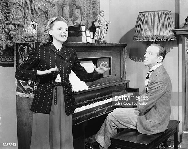 Fred Astaire enjoys a private performance from Judy Garland in a scene from the MGM film 'Easter Parade' directed by Charles Walters 5th January 1948