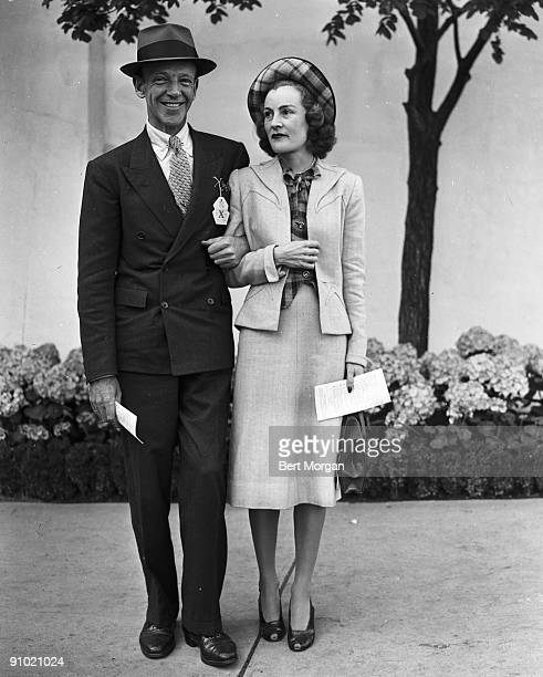 Fred Astaire famed dancer singer and actor with wife Phyllis at Belmont Park NY 1951