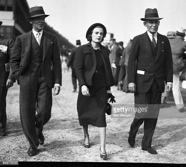 Fred Astaire famous dancer singer and actor with his wife Phyllis and Mr Henry W Bull attending the races at Aqueduct Raceway in New York September...