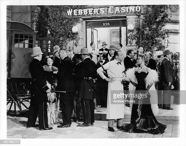Fred Astaire meeting with VeraEllen outside casino in a scene from the film 'The Belle Of New York' 1952