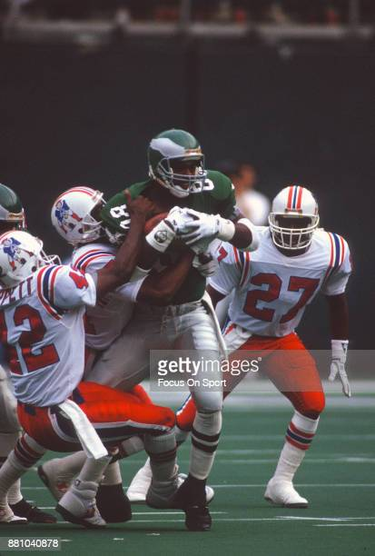 Fred Barnett of the Philadelphia Eagles gets tackled by Ronnie Lippett of the New England Patriots during an NFL football game November 4 1990 at...