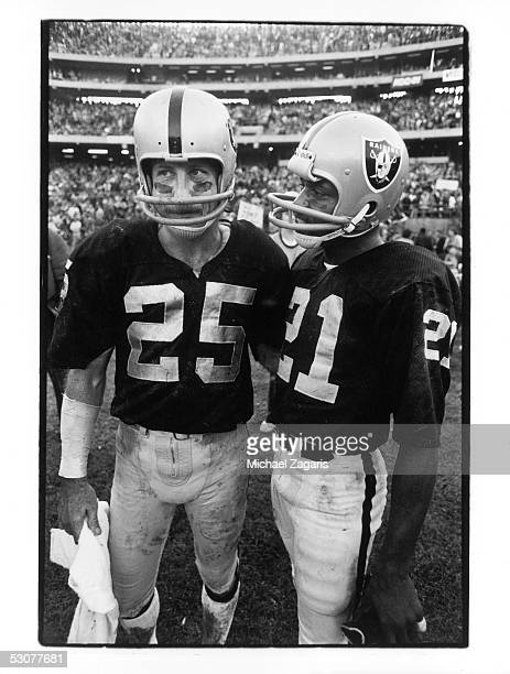 Fred Biletnikoff and Cliff Branch of the Oakland Raiders look on from the sidelines during the 1976 AFC Divisional Playoff game against the New...