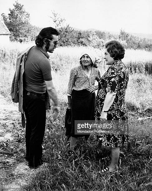 Fred Bongusto , Italian pop-music singer, guest in his parents' village of origin in Molise, talks with his mother, on the right, and Zi Maria, an...