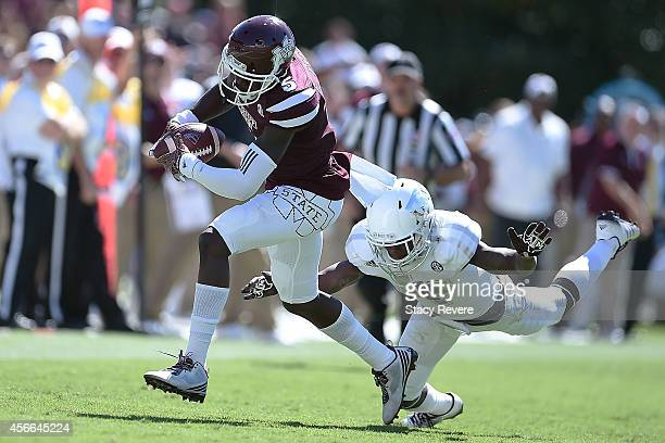 Fred Brown of the Mississippi State Bulldogs catches a pass in front of De'Vante Harris of the Texas AM Aggies during the third quarter of a game at...