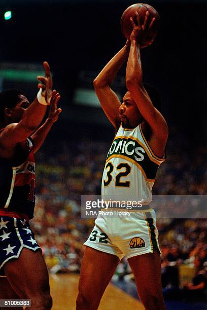 Fred Brown of the Seatte Supersonics looks to pass against the Washington Bullets during game one of the 1978 NBA FInals at the Kingdome on May 21...