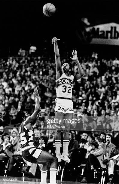Fred Brown of the Seattle Sonics shoots a jumpshot during an NBA game in Seattle Washington NOTE TO USER User expressly acknowledges that by...