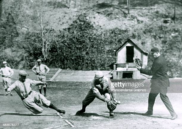 Fred Clarke slides home during a practice game at spring training around 1905 in Hot Springs Arkansas