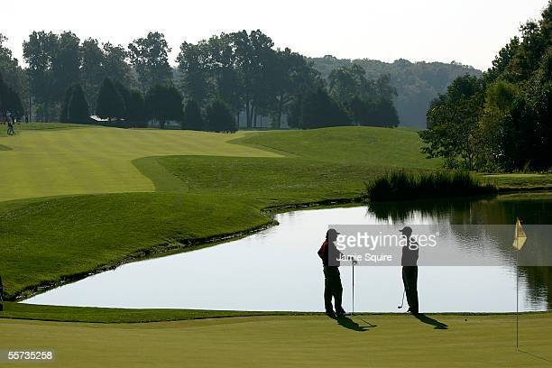 Fred Couples and Tiger Woods of the USA talk while practicing together during a practice round for the 2005 Presidents Cup on September 21, 2005 at...