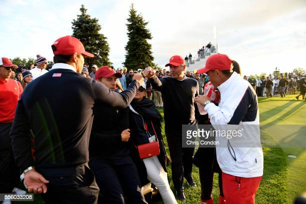 Fred Couples Captains Assistant of the US Team fist pumps with US Team during the afternoon fourball matches at the Presidents Cup at Liberty...