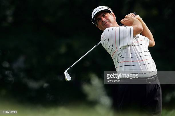 Fred Couples hits an iron shot during the second round of the 2006 PGA Championship at Medinah Country Club on August 18 2006 in Medinah Illinois