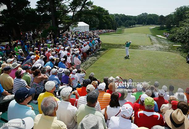 Fred Couples hits his tee shot on the first hole during the final round of the 2013 US Senior Open Championship at Omaha Country Club on July 14 2013...
