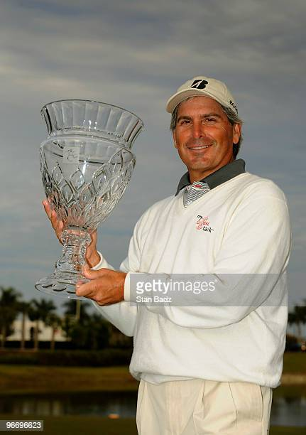 Fred Couples holds the winner's trophy after the final round of The ACE Group Classic at The Quarry on February 14, 2010 in Naples, Florida. This was...