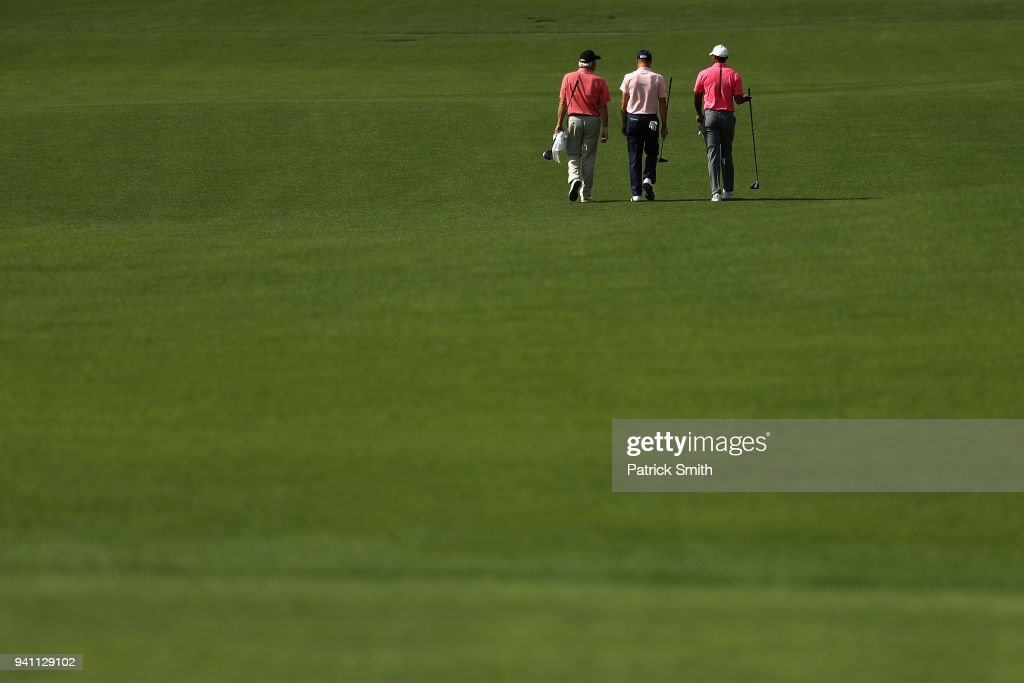 Fred Couples, Justin Thomas and Tiger Woods of the United States walk together during a practice round prior to the start of the 2018 Masters Tournament at Augusta National Golf Club on April 2, 2018 in Augusta, Georgia.