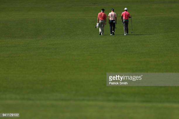 Fred Couples Justin Thomas and Tiger Woods of the United States walk together during a practice round prior to the start of the 2018 Masters...