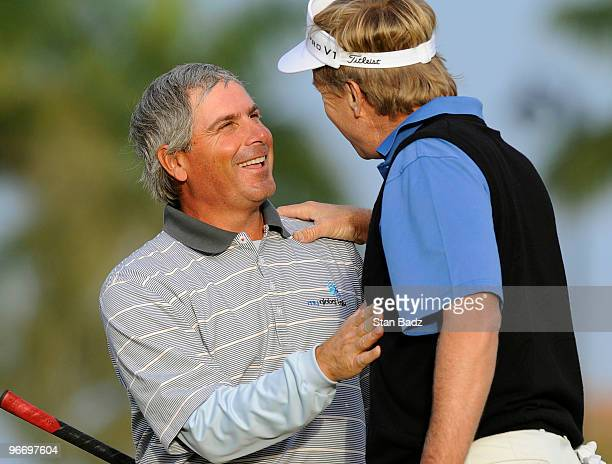 Fred Couples left is congratulated by Dan Forsman right on his first win on the Champions Tour at the 18th green during the final round of The ACE...