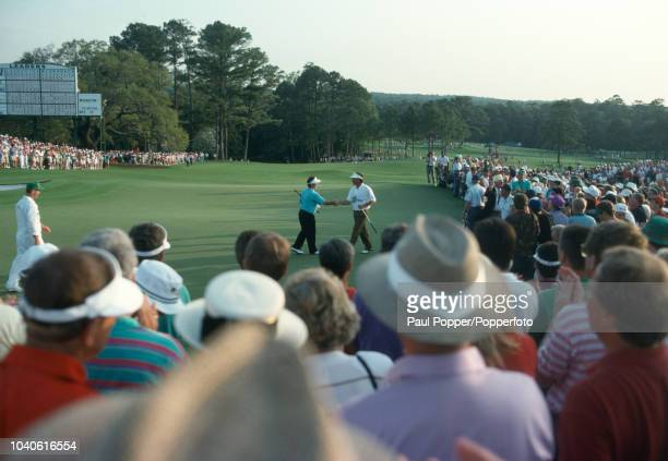 Fred Couples of the United States and Craig Parry of Australia after the final hole during the US Masters Golf Tournament held at The Augusta...