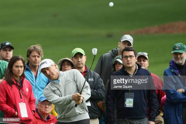 Fred Couples of the United States chips on the second hole during the third round of the 2018 Masters Tournament at Augusta National Golf Club on...