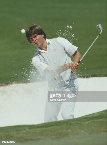 Fred Couples of the United States chips out of the sand bunker on 11 April 1985 during the US Masters Golf Tournament at the Augusta National Golf...