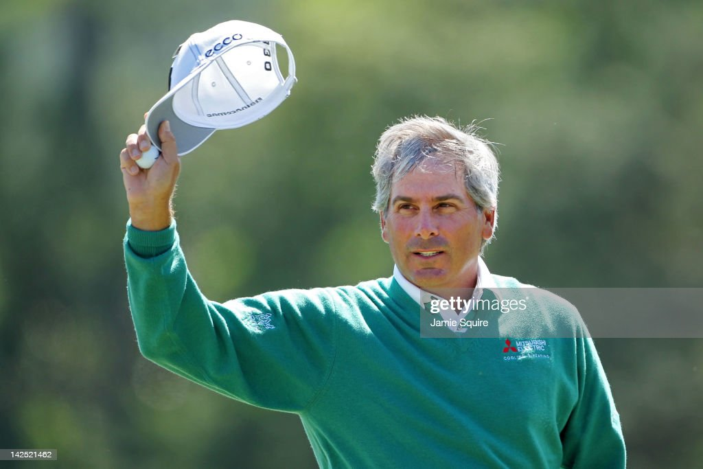 Fred Couples of the United States gestures to the gallery from the 18th green after finishing the second round of the 2012 Masters Tournament at Augusta National Golf Club on April 6, 2012 in Augusta, Georgia.
