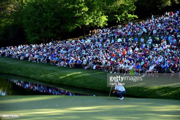 Fred Couples of the United States lines up a putt on the 16th green during the third round of the 2017 Masters Tournament at Augusta National Golf...