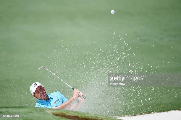 Fred Couples of the United States plays a bunker shot on the second hole during the final round of the 2014 Masters Tournament at Augusta National...