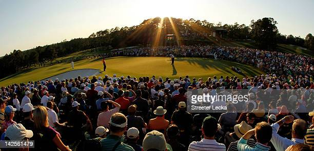 Fred Couples of the United States putts on the 18th hole during the third round of the 2012 Masters Tournament at Augusta National Golf Club on April...