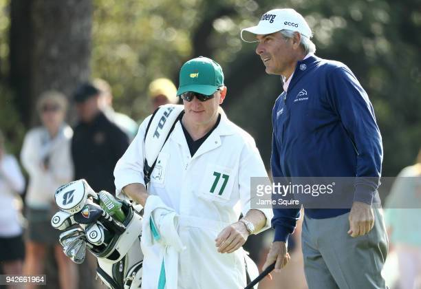 Fred Couples of the United States talks with caddie Mark Chaney on the first hole during the second round of the 2018 Masters Tournament at Augusta...
