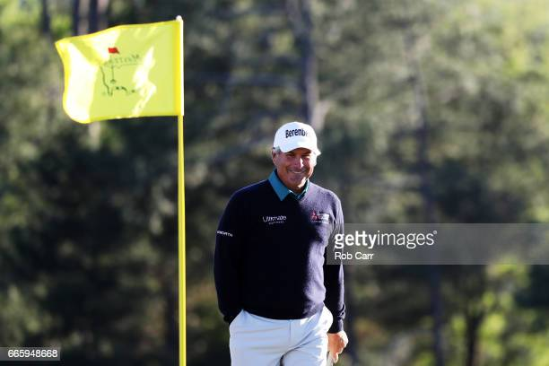 Fred Couples of the United States walks on the 18th green during the second round of the 2017 Masters Tournament at Augusta National Golf Club on...