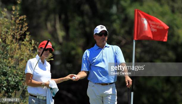 Fred Couples of the USA with his girlfriend caddying for him during the proam ahead of the 2011 Emirates Australian open at The Lakes Golf Club on...