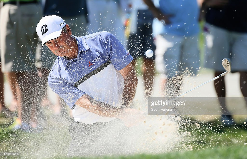 Fred Couples plays a bunker shot on the 11th hole during the first round of the 2013 U.S. Senior Open Championship at Omaha Coutry Club on July 11, 2013 in Omaha, Nebraska.