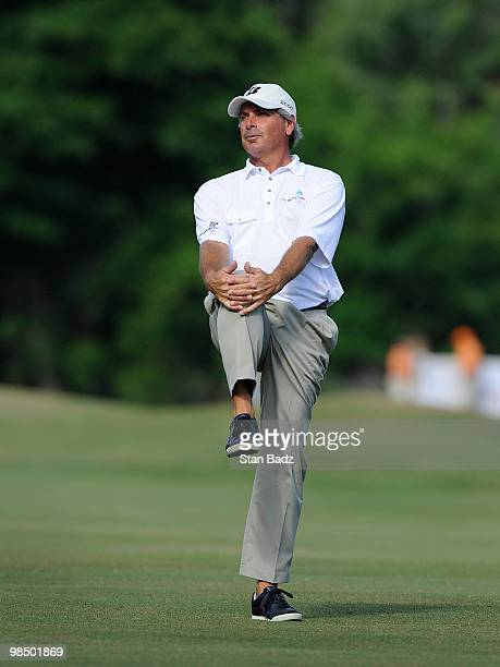 Fred Couples waits for play on the 16th fairway during the first round of the Outback Steakhouse ProAm at TPC Tampa Bay on April 16 2010 in Lutz...
