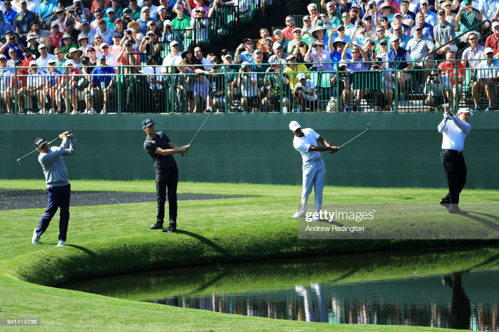 Fred Couples,Tiger Woods, Phil Mickelson of the United States and Thomas Pieters of Belgium skip balls on the 16th hole during a practice round prior to the start of the 2018 Masters Tournament at Augusta National Golf Club on April 3, 2018 in Augusta, Georgia.