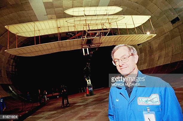 Fred Culick Project Engineer and the first pilot who will fly the Wright Flyer in the year 2003 poses in front of the test plane on which NASA is...